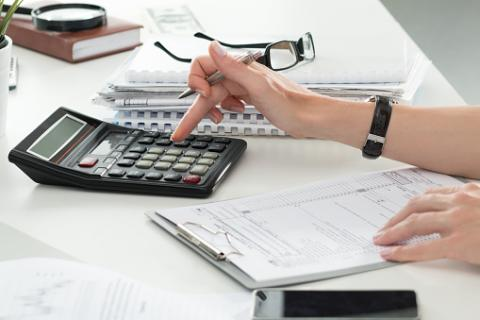 PHOTO: Thinkstock.com. Close up of female accountant making calculations