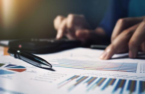 PHOTO: Thinkstock.com. Close up pen on paperwork and woman hand calculate finance.